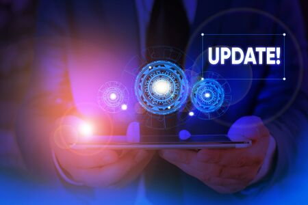 Writing note showing UPDATE. Business concept for make something more modern or up to date like software program Male wear formal suit presenting presentation smart device Stok Fotoğraf