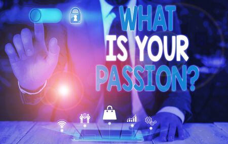 Handwriting text What Is Your Passion Question. Conceptual photo asking about his strong and barely controllable emotion Male human wear formal work suit presenting presentation using smart device