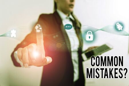 Text sign showing Common Mistakes Question. Business photo text repeat act or judgement misguided making something wrong Female human wear formal work suit presenting presentation use smart device Imagens