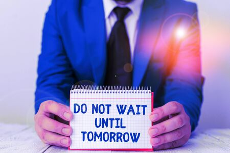 Word writing text Do Not Wait Until Tomorrow. Business photo showcasing needed to do it right away Urgent Better do now Man holds empty paper with copy space in front of him Space