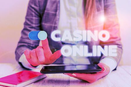 Conceptual hand writing showing Casino Online. Concept meaning Computer Poker Game Gamble Royal Bet Lotto High Stakes Business concept with communication mobile phone 스톡 콘텐츠