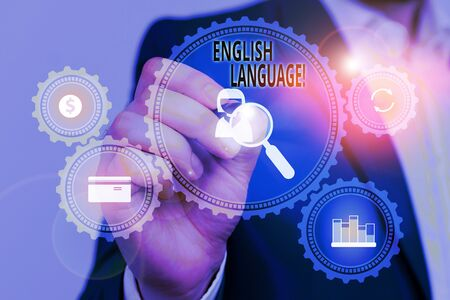 Handwriting text English Language. Conceptual photo third spoken native lang in world after Chinese and Spanish Male human wear formal work suit presenting presentation using smart device