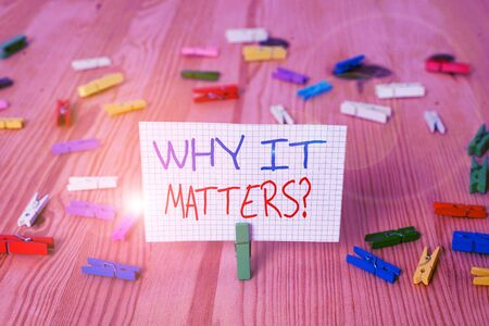 Text sign showing Why It Matters question. Business photo text ask demonstrating about something he think is important Colored clothespin papers empty reminder wooden floor background office Stok Fotoğraf