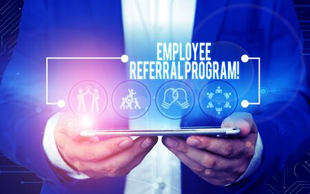 Text sign showing Employee Referral Program. Business photo text internal recruitment method employed by organizations Male human wear formal work suit presenting presentation using smart device Stock Photo
