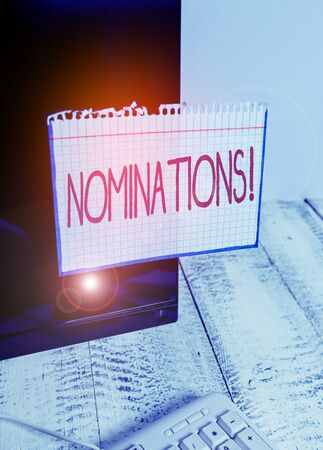 Text sign showing Nominations. Business photo text action of nominating or state being nominated for prize Notation paper taped to black computer monitor screen near white keyboard