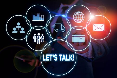 Text sign showing Let S Talk. Business photo showcasing they are suggesting beginning conversation on specific topic Male human wear formal work suit presenting presentation using smart device
