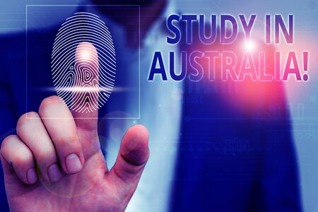 Handwriting text Study In Australia. Conceptual photo going into foreign country order complete your studies Male human wear formal work suit presenting presentation using smart device Reklamní fotografie