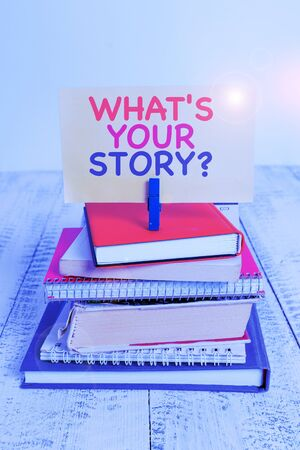 Conceptual hand writing showing What S Is Your Story question. Concept meaning analysisner of asking demonstrating about past life events pile stacked books notebook pin color reminder white wooden Stock fotó