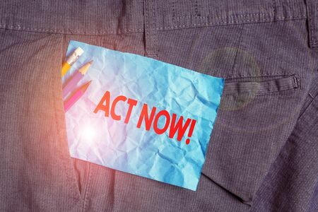Text sign showing Act Now. Business photo showcasing fulfil the function or serve the purpose of Take action Do something Writing equipment and blue note paper inside pocket of man work trousers