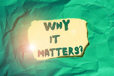 Writing note showing Why It Matters question. Business concept for ask demonstrating about something he think is important Green crumpled colored paper sheet torn colorful background