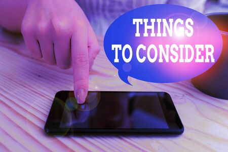 Text sign showing Things To Consider. Business photo text think about carefully especially in making decisions woman using smartphone office supplies technological devices inside home