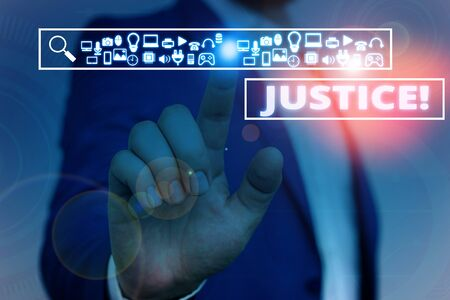 Text sign showing Justice. Business photo showcasing impartial adjustment of conflicting claims or assignments Male human wear formal work suit presenting presentation using smart device