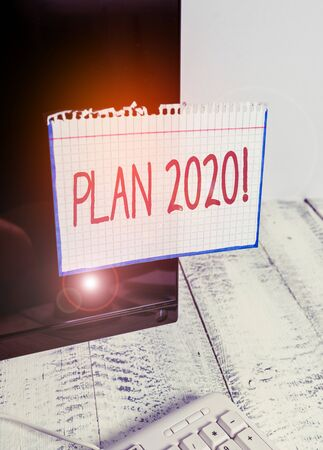 Text sign showing Plan 2020. Business photo text detailed proposal doing achieving something next year Notation paper taped to black computer monitor screen near white keyboard