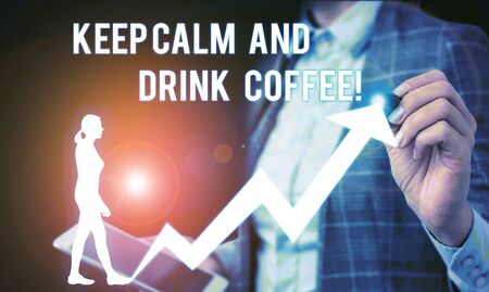 Conceptual hand writing showing Keep Calm And Drink Coffee. Concept meaning encourage demonstrating to enjoy caffeine drink and relax Female human wear formal work suit presenting smart device