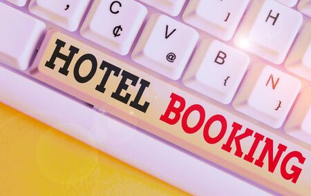 Text sign showing Hotel Booking. Business photo text Online Reservations Presidential Suite De Luxe Hospitality White pc keyboard with empty note paper above white background key copy space