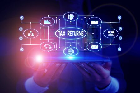 Text sign showing Tax Returns. Business photo showcasing Tax payer financial information Tax Liability and Payment report Woman wear formal work suit presenting presentation using smart device
