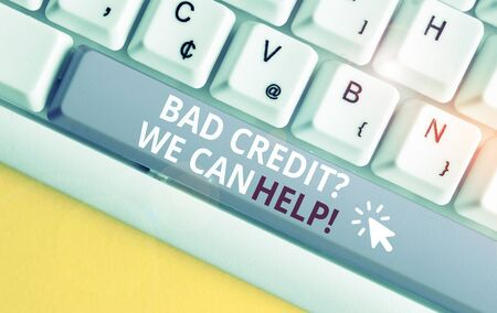 Writing note showing Bad Creditquestion We Can Help. Business concept for offerr help to gain positive payment history White pc keyboard with note paper above the white background