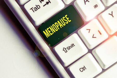 Handwriting text writing Menopause. Conceptual photo Period of peranalysisent cessation or end of menstruation cycle White pc keyboard with empty note paper above white background key copy space