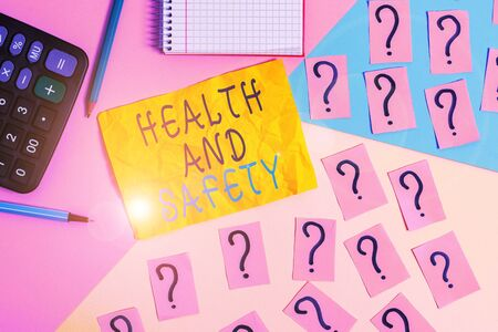 Writing note showing Health And Safety. Business concept for procedures intended to prevent accident in workplace Mathematics stuff and writing equipment above pastel colours background Reklamní fotografie