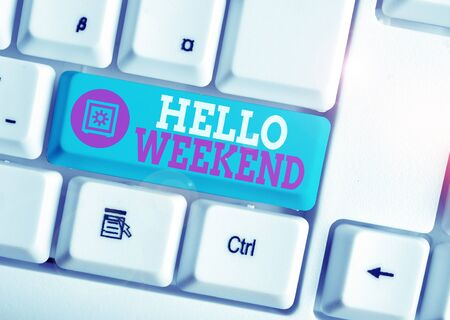 Writing note showing Hello Weekend. Business concept for Getaway Adventure Friday Positivity Relaxation Invitation White pc keyboard with note paper above the white background