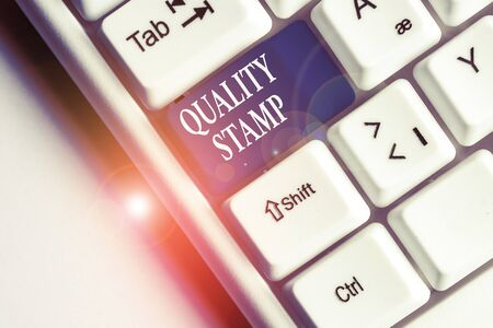 Text sign showing Quality Stamp. Business photo text Seal of Approval Good Impression Qualified Passed Inspection White pc keyboard with empty note paper above white background key copy space Imagens