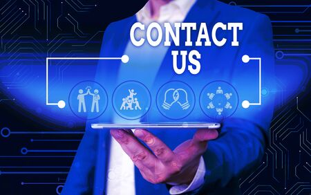 Conceptual hand writing showing Contact Us. Concept meaning Group of demonstrating that rendering costumer service through telecom Male wear formal work suit presenting presentation smart device