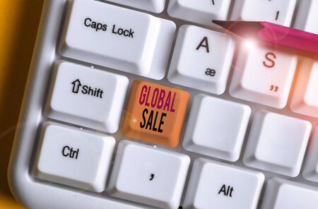 Conceptual hand writing showing Global Sale. Concept meaning analysisagers operations for companies do business internationally White pc keyboard with note paper above the white background Stockfoto
