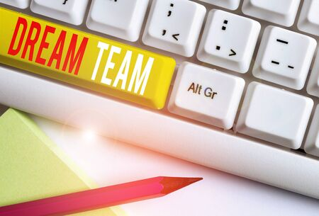 Handwriting text writing Dream Team. Conceptual photo Prefered unit or group that make the best out of a demonstrating White pc keyboard with empty note paper above white background key copy space Stock Photo
