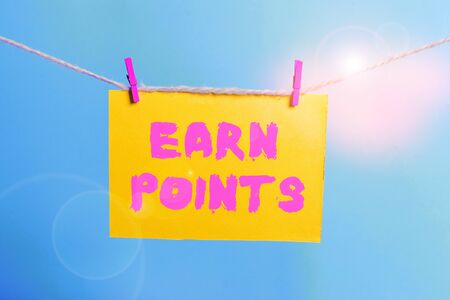 Conceptual hand writing showing Earn Points. Concept meaning getting praise or approval for something you have done Clothespin rectangle shaped paper reminder white wood desk 스톡 콘텐츠