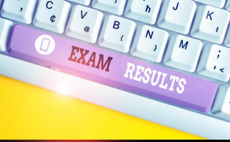 Conceptual hand writing showing Exam Results. Concept meaning An outcome of a formal test that shows knowledge or ability White pc keyboard with note paper above the white background