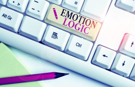 Handwriting text writing Emotion Logic. Conceptual photo Heart or Brain Soul or Intelligence Confusion Equal Balance White pc keyboard with empty note paper above white background key copy space
