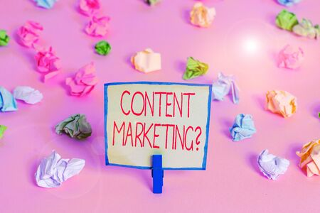 Text sign showing Content Marketing Question. Business photo text involves creation and sharing of online material Colored crumpled papers empty reminder pink floor background clothespin Stok Fotoğraf