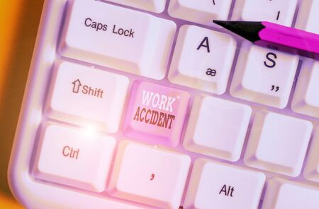 Writing note showing Work Accident. Business concept for Mistake Injury happened in the job place Getting hurt White pc keyboard with note paper above the white background Zdjęcie Seryjne