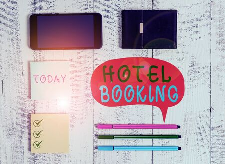 Word writing text Hotel Booking. Business photo showcasing Online Reservations Presidential Suite De Luxe Hospitality Smartphone pens blank speech bubble sticky notes wallet wooden background Stok Fotoğraf
