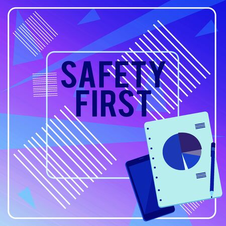 Conceptual hand writing showing Safety First. Concept meaning Avoid any unnecessary risk Live Safely Be Careful Pay attention Layout Smartphone Off Ballpoint Notepad Business Pie Chart 写真素材