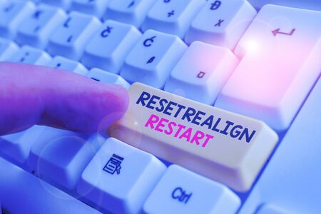 Writing note showing Reset Realign Restart. Business concept for Life audit will help you put things in perspectives White pc keyboard with note paper above the white background 写真素材
