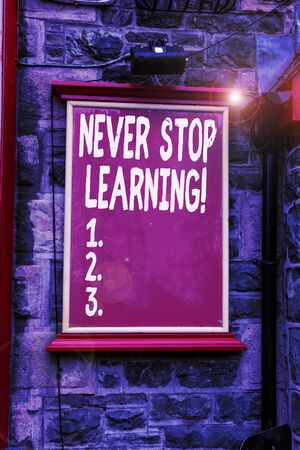 Conceptual hand writing showing Never Stop Learning. Concept meaning keep on studying gaining new knowledge or materials Blank board copy space for commercial advertising on wall