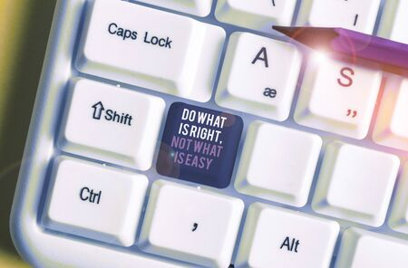 Writing note showing Do What Is Right Not What Is Easy. Business concept for willing to stand up for what is right White pc keyboard with note paper above the white background