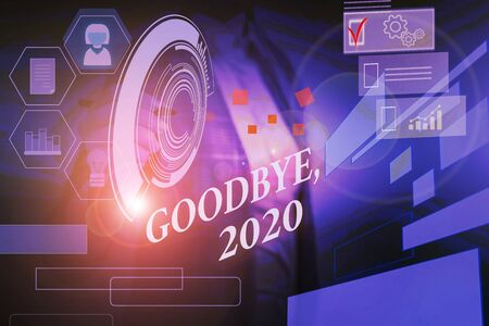 Word writing text Goodbye 2020. Business photo showcasing New Year Eve Milestone Last Month Celebration Transition Woman wear formal work suit presenting presentation using smart device Imagens - 131971468