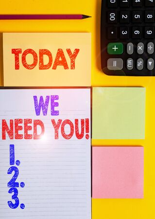 Writing note showing We Need You. Business concept for asking someone to work together for certain job or target Colored empty papers with copy space on the yellow background table Imagens