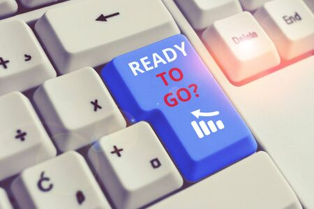 Conceptual hand writing showing Ready To Go Question. Concept meaning asking someone if he is prepared or packed his things White pc keyboard with note paper above the white background