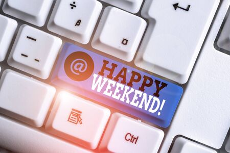 Text sign showing Happy Weekend. Business photo showcasing something nice has happened or they feel satisfied with life White pc keyboard with empty note paper above white background key copy space Stock Photo