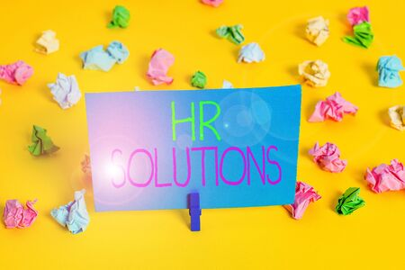 Writing note showing Hr Solutions. Business concept for Outsourced Huanalysis resources consultancy and support Experts Colored crumpled paper empty reminder white floor clothespin Imagens
