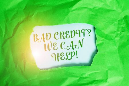 Text sign showing Bad Creditquestion We Can Help. Business photo text offerr help to gain positive payment history Green crumpled ripped colored paper sheet centre torn colorful background