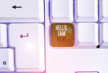 Text sign showing Hello I Am New. Business photo showcasing introducing oneself in a group as fresh worker or student White pc keyboard with empty note paper above white background key copy space