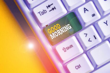 Conceptual hand writing showing Good Morning. Concept meaning A conventional expression at meeting or parting in the morning White pc keyboard with note paper above the white background