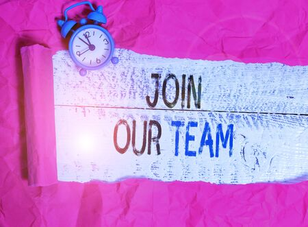 Writing note showing Join Our Team. Business concept for inviting someone to join in your local group or company Banco de Imagens