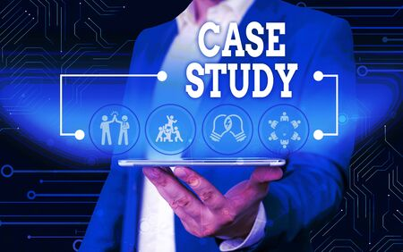 Conceptual hand writing showing Case Study. Concept meaning A subject matter to be discussed and related to the topic Male wear formal work suit presenting presentation smart device