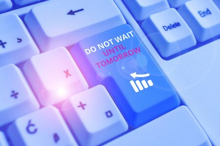Conceptual hand writing showing Do Not Wait Until Tomorrow. Concept meaning needed to do it right away Urgent Better do now White pc keyboard with note paper above the white background
