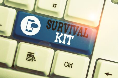 Conceptual hand writing showing Survival Kit. Concept meaning Emergency Equipment Collection of items to help someone Keyboard with note paper on white background key copy space